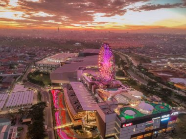 Cakung, East Jakarta, Indonesia (02/Mei/2019) : Aerial view of the sunset with colorful clouds at Aeon Mall JGC