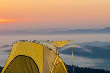 Yellow tent at View point at Doi Sa-Ngo, Chiang Sean, Chiang Rai Province, Thailand.