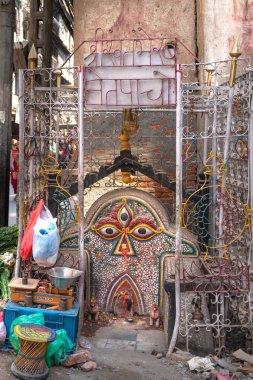 Kathmandu, Nepal - March 18, 2019: holy corner and street market