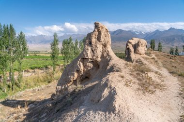 The view of old ancient ruined city Koshoy Korgon and the clay city wall in Kyrgyzstan