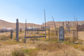 The view of old traditional graveyard in small remote village in Kyrgyzstan