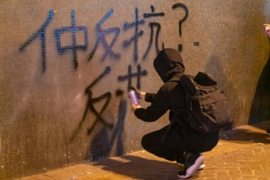 An activist draws graffiti at the people's rally for defending their freedoms and rights stock vector