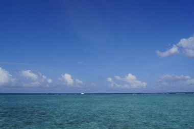 Beautiful sky and turquoise water of the Indian Ocean on a clear day. Maldives