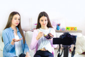 Two beauty blogger cute girls presenting beauty cosmetic products and broadcasting live video to social network. Focus on the blogger teen girls influencer. Beauty blogger and vlog concept for teenager followers.