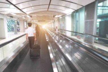 blur image of passengers in airport terminal