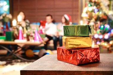Christmas gift box in xmas party with people in party blur background