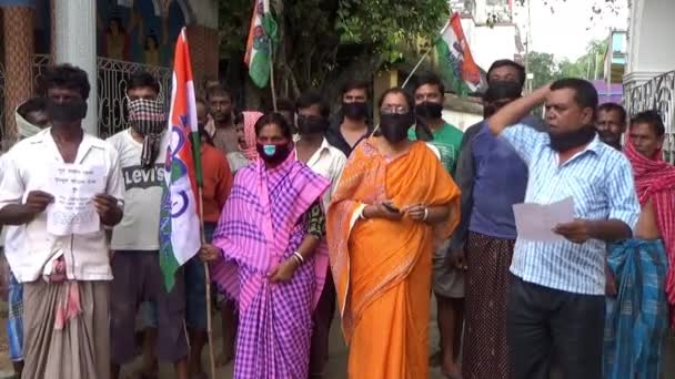 Kolkata, West Bengal, India - July 08, 2020; All India Trinamool Congress party workers in West Bengal, India, protesting against the central government hike in petroleum prices and privatization of various government agencies by wearing black masks