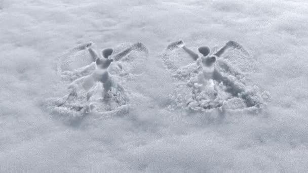 invisible men making snow angels design on a fresh snow