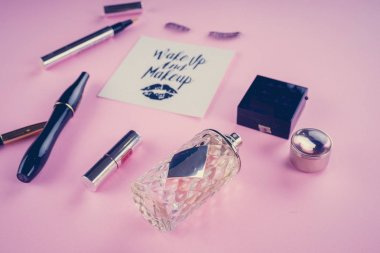 makeup tools on a pink background