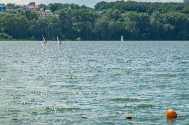 Beautiful urban lake boats nature background