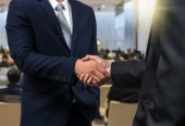 Fotografie Business shaking hands of partner over the Abstract blurred photo of conference hall or seminar room with attendee background, business success and partnership concept
