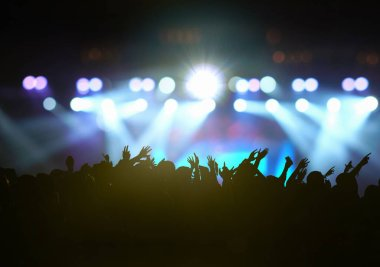 Concert crowd in silhouettes of Music fanclub with show hand action which follow up the songer at the front of stage with follow light, musical and concert concept stock vector