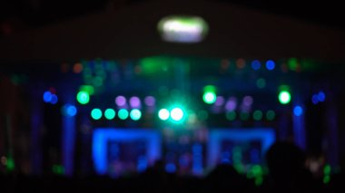 Abstract blurred photo of spotlight in conference hall, seminar and party environment concept