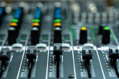 Closeup some part of audio mixer, vintage film style, music equipment concept