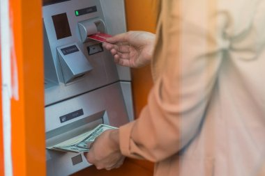 woman withdrawing the cash via ATM, business Automatic Teller Machine concept