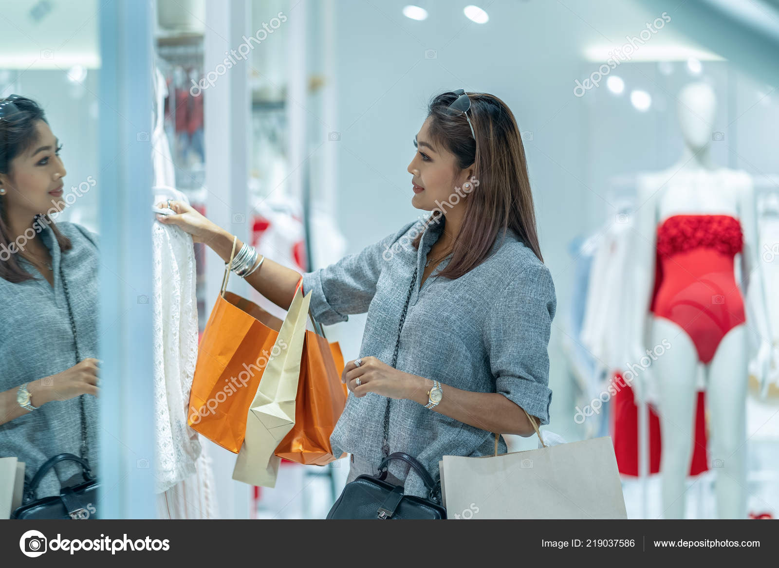 b8e00b8bc Asian woman looking and choosing the underwear in store shop with happy  action at department center — Photo by ...