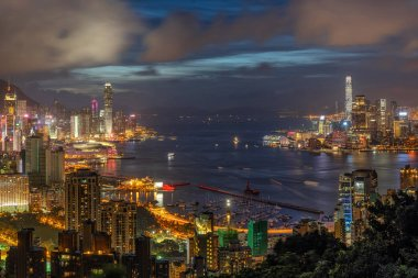 Hong Kong Cityscape skyscraper at twilight time, Hong Kong central and Kowloon island, Victoria peak and harbour, adventure and trekking at red incense burner summit view point for traveler