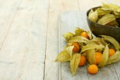 Fotografie fresh fruit physalis on the table