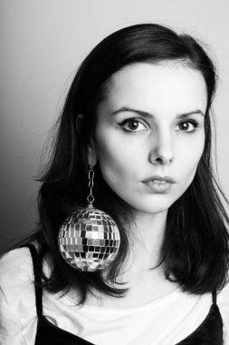 young woman with disco ball black white photography