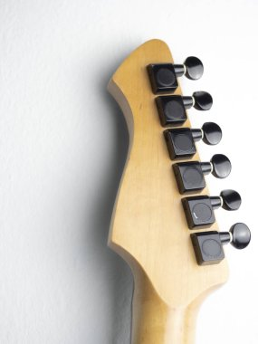 Electric guitar with a wood headstock