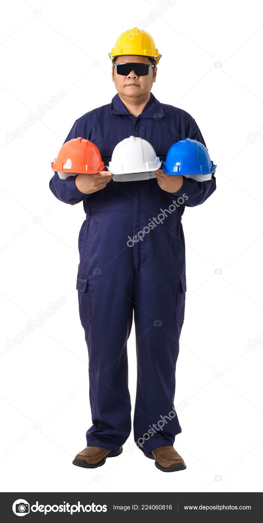 3fd6ea2176d Full body portrait of a worker in Mechanic Jumpsuit holding helmet  multicolor with Safety goggles isolated on white background clipping path —  Photo by ...