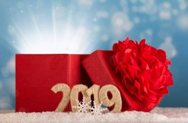 Magic gift of magic and the inscription 2019 new year in the snow on a blue background