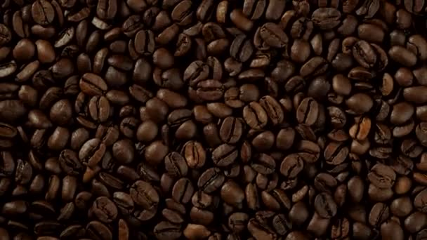 roasted coffee beans background rotation closeup top view