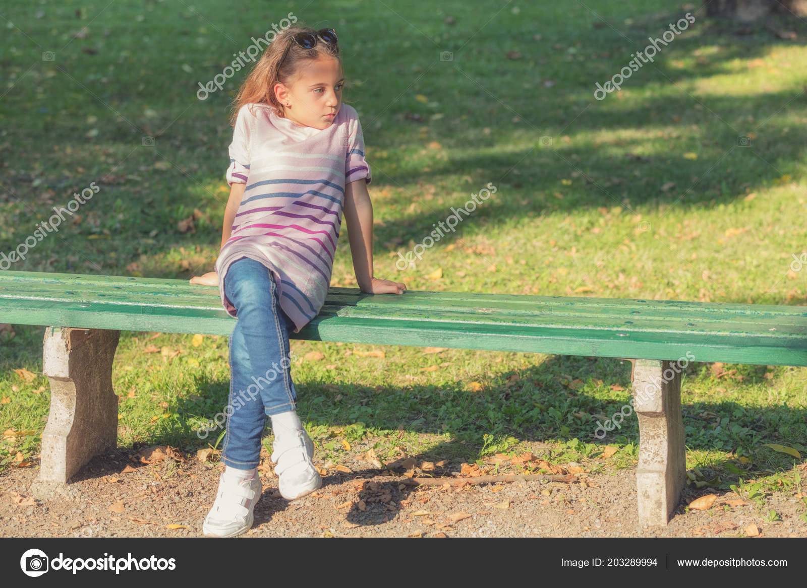 Remarkable Little Girl Sitting Wooden Bench Park Sunny Day Stock Ocoug Best Dining Table And Chair Ideas Images Ocougorg