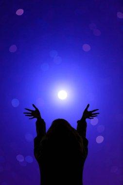 Girl watching the stars at night
