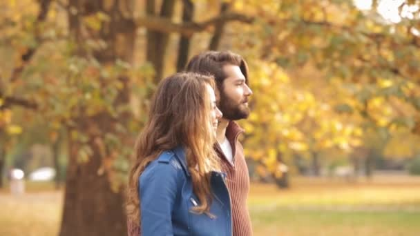 Young couple dating in autumnal park