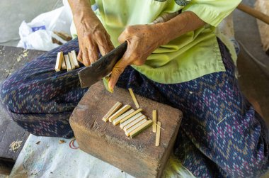Traditional thai umbrella manufacture handwork woman cut parts of umbrella - close up