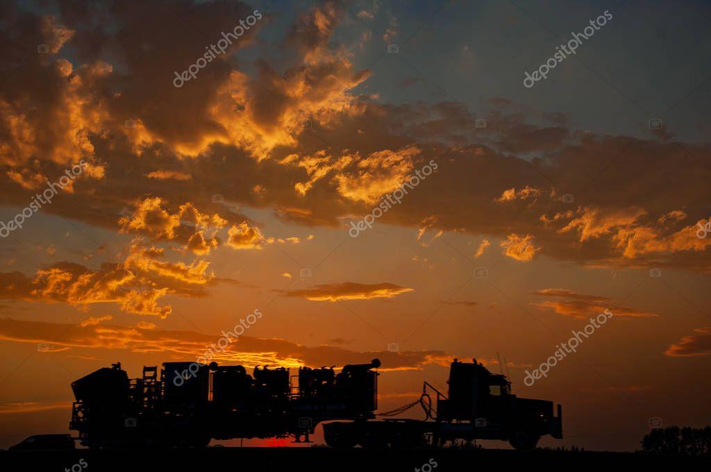 Semi truck on sunset background