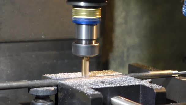 drilling holes in the drilling machine