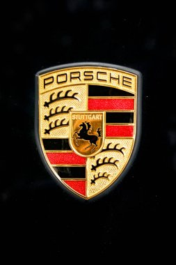 Madrid, Madrid, Spain; 10/08/2007; Badge, logo, badge of a vehicle of the brand Porsche of color of black sheet