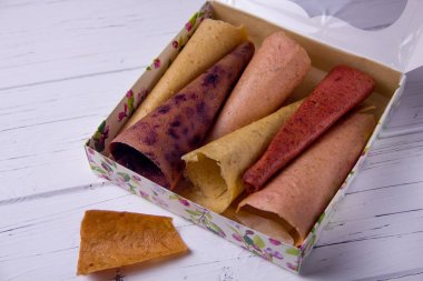 handmade homemade pastila in a box on a light background. A set of different fruits, fruit candy with apples, fruit candy with strawberries, fruit candy with currants