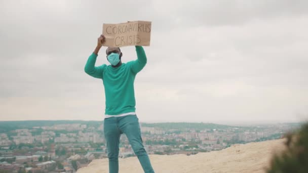 Unemployed doctor with strike banner fighting for employment on mountain top due to quarantine. Coronavirus outbreak. Global crisis 2020. Pandemic.