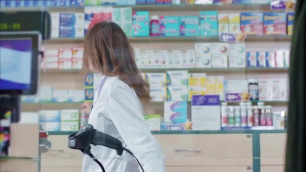 Pretty young female pharmacist consultant consulting male patient and giving medication sharing recommendations in drugstore. Healthcare, medicine.