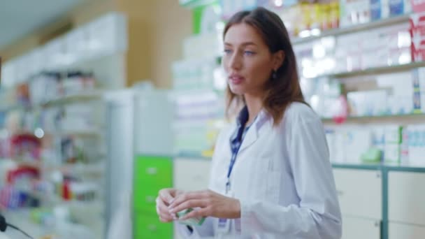 Young beautiful smart woman apothecarist searching medicine online reading computer screen prescription of drugs examining medication. Drugstore worker. Healthcare.