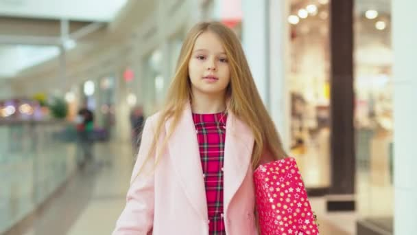 Happy smiling girl walk in the shopping mall with Christmas present boxes child family attractive teenager beautiful children cheerful happiness holiday kid smiling childhood slow motion