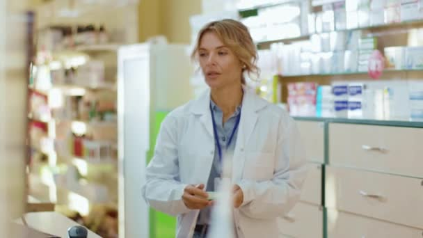 Serious tired woman pharmacist serving a customer in a drugstore. Conversation pharmaceutical client. Seller commercial health care buyer uniform. Slow motion