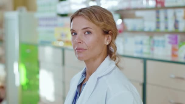 Close up face serious young woman in uniform pharmacist at pharmacy stand look at camera tired. Diagnosis young pharmaceutics store job healthy medicine. Slow motion