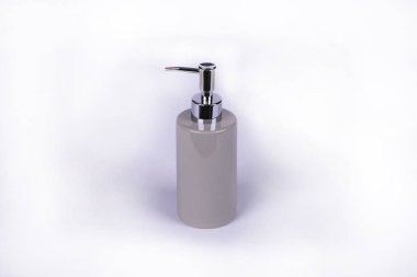 Dispenser for liquid soap on a light background. Hygiene products.