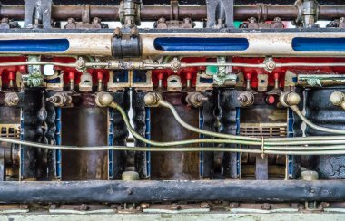 Closeup of old ships engine texture. Copper pipe. Difficult communication, retro, texture a lot of pipes