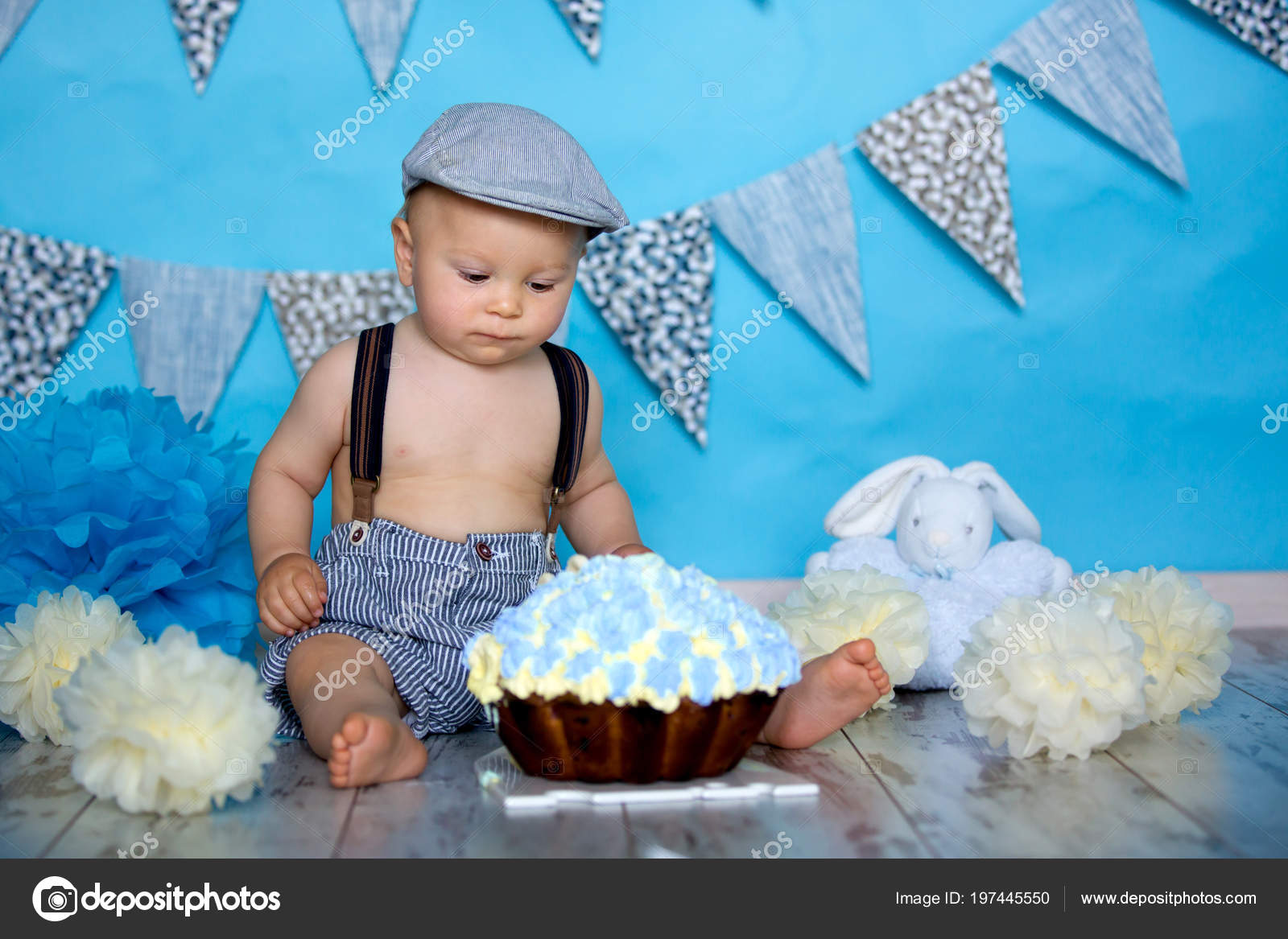 Little Baby Boy Celebrating His First Birthday Smash Cake Party