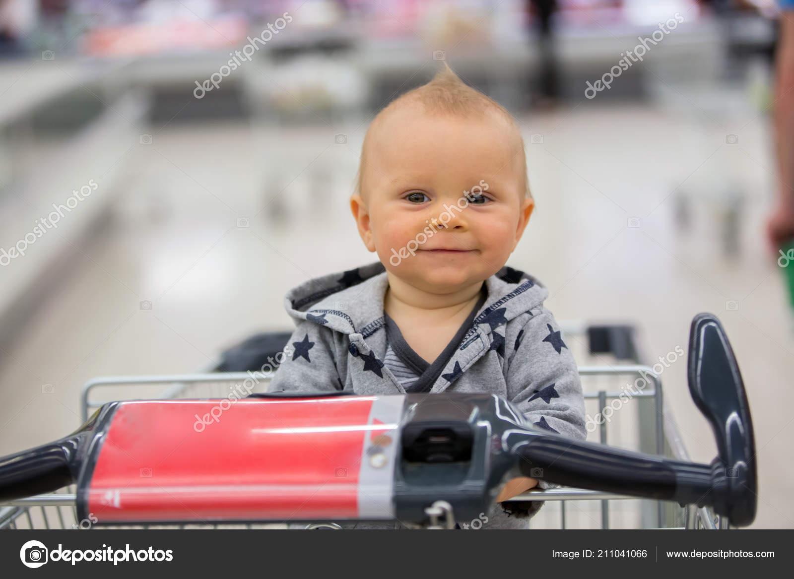2d567eae8 Toddler Baby Boy Sitting Shopping Cart Grocery Store Smiling Eating ...