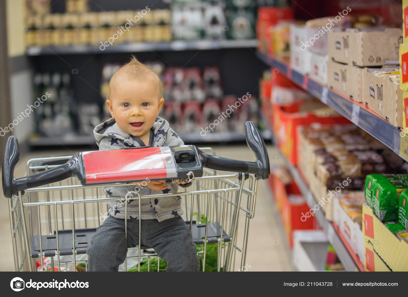b55f5463a Toddler Baby Boy Sitting Shopping Cart Grocery Store Smiling Eating ...