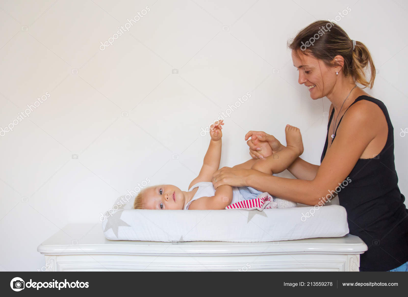 Happy Mother Playing Baby While Changing His Diaper Smiling Young