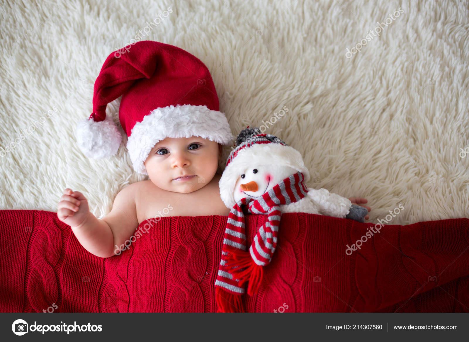 f868196aa8082 Christmas Portrait Cute Little Newborn Baby Boy Wearing Santa Hat– stock  image