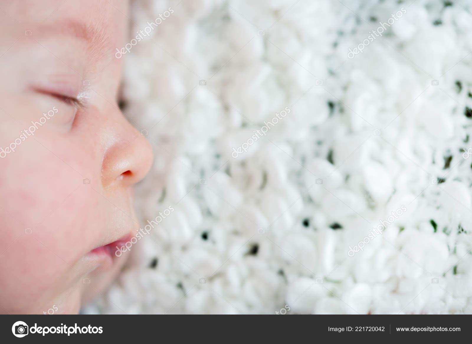 Beautiful newborn baby boy sleeping little toy stock image