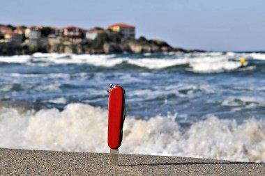 Pocket folding knife stainless blade sea beautiful landscape waves horizon travel vacation